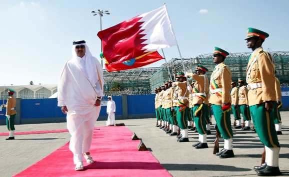 Qatari Emir Sheikh Tamim bin Hamad al-Thani inspects a guard of honor upon arriving at the Bole International Airport during his official visit to Ethiopia's capital Addis Ababa