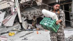 TOPSHOT - Turkish-backed Syrian Arab fighters loot shops after seizing control of the northwestern Syrian city of Afrin from the Kurdish People's Protection Units (YPG) on March 18, 2018. In a major victory for Ankara's two-month operation against the Kurdish People's Protection Units (YPG) in northern Syria, Turkish-led forces pushed into Afrin apparently unopposed, taking up positions across the city. / AFP PHOTO / BULENT KILIC (Photo credit should read BULENT KILIC/AFP/Getty Images)